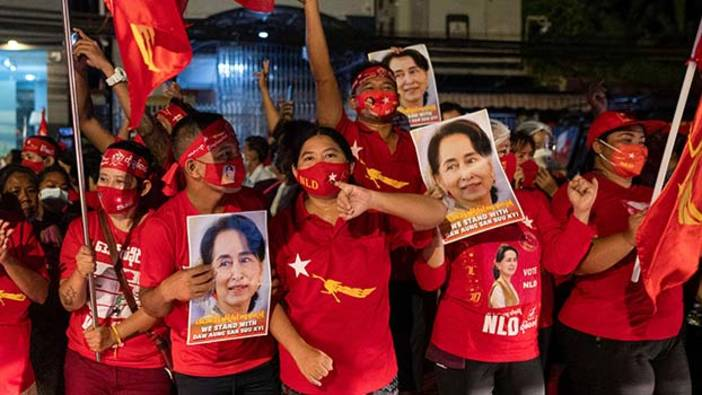 Supporters of National League for Democracy celebrate at party headquarters after the general election in Yangon, Myanmar, November 9, 2020.