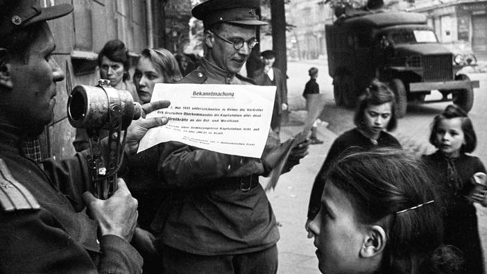 Reading of the surrender in the streets of Berlin on May 8, 1945.