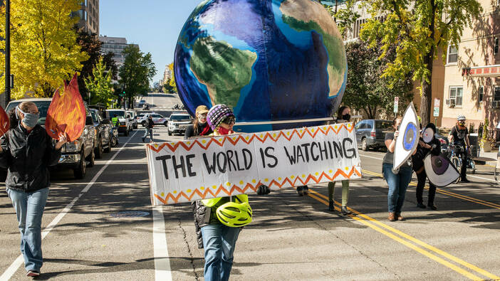Climate activists protest against President Trump in Washington, DC on 4 November 2020.